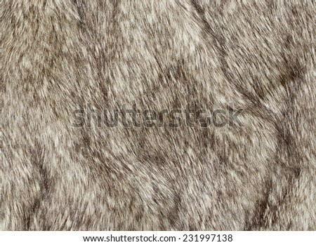 Faux fur fabric for the fashion industry used to artificially recreate animal pelts including reindeer and coyote. The use of a fake synthetic version not causing offence with animal rights activists. - stock photo