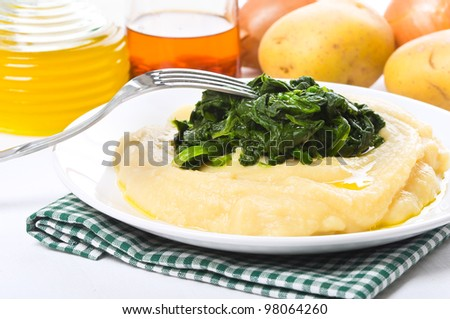 Fava bean puree with spinach. - stock photo