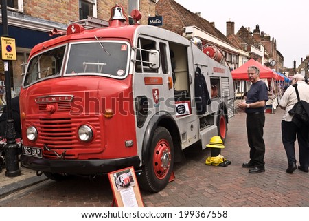 Faversham, UK- MAY 17: A vintage fire Engine is on display on the streets of Faversham as part of the Transport Weekend that attracts thousands of visitors to the town. May 17 2014 in Favershan UK. - stock photo