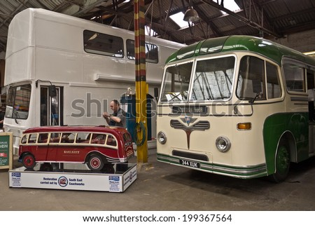 FAVERSHAM, UK-MAY 17: Visitors enjoy the South East Coach Works displays and models, part of the Transport weekend that attracts thousands of visitors each year. May 17, 2014 in Faversham UK. - stock photo