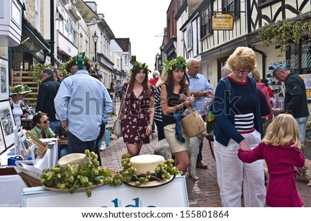 FAVERSHAM, UK-SEPTEMBER 1:  Visitors and stalls decorated with hops at the annual Hop Festival, in Faversham, which celebrates the hop picking tradition in Kent. September 1, 2013 , Faversham,  UK.