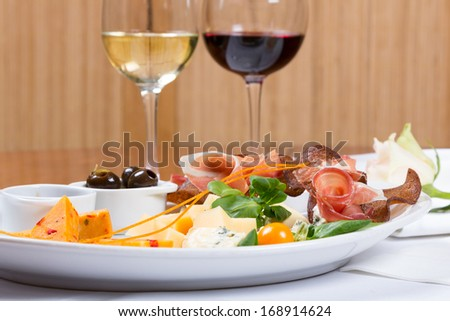Favorites cheese snack with jam, marinated olives and croutons - stock photo