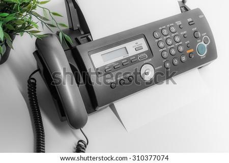 Fax machine, communication - stock photo