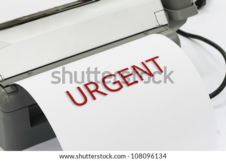 fax machine with urgent letter on document