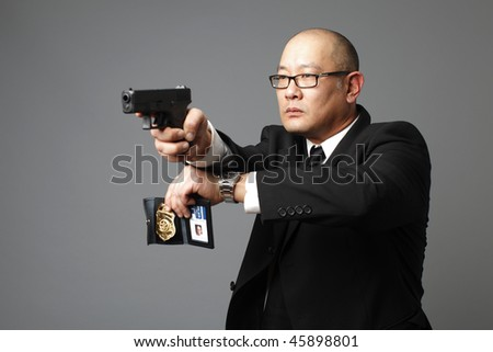 FBI agent with gun and badge.