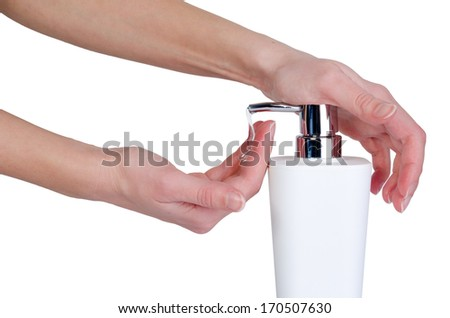 Feamle hands using a liquid soap - isolated on white - stock photo