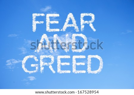 fear and greed clouds word on sky. - stock photo