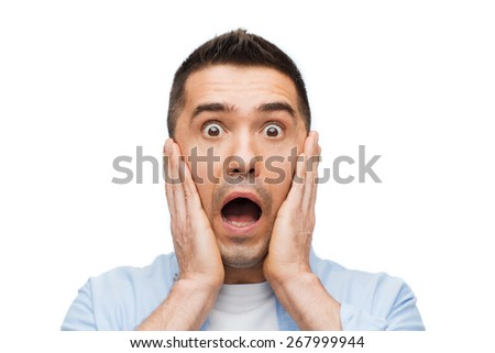 fear, emotions, horror and people concept - scared man shouting and touching his face - stock photo