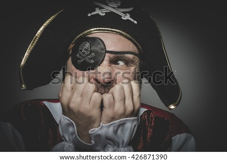 Fear pirate with eye patch and old hat with funny faces and expressive - stock photo