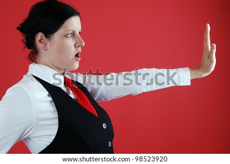 fearful looking businesswoman with stopping gesture