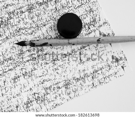 feather and calligraphy - stock photo