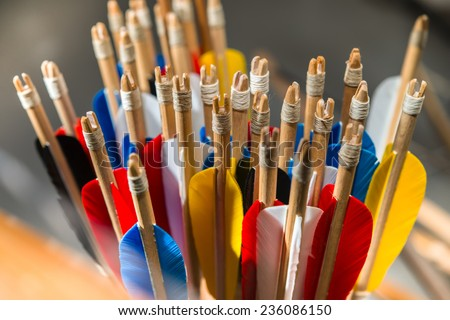 Feathering arrows from a bow in the quiver, many - stock photo