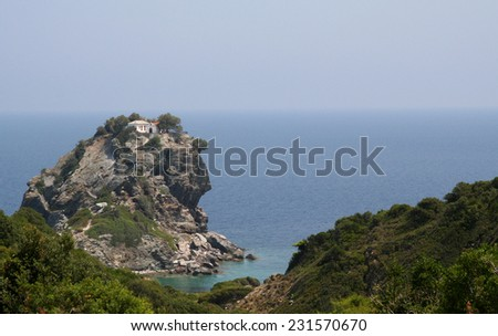 Featured in the hit film musical 'Mama Mia', the chapel of St John the Baptist sits dramatically on the top of a finger of rock off the island of Skopelos in the Aegean sea in Greece. - stock photo