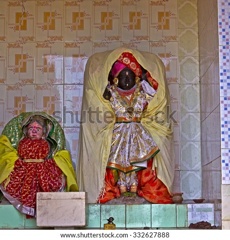 FEB 8, 2015, DWARKA, INDIA - Deities of Radha and Krishna in a small Hindu temple