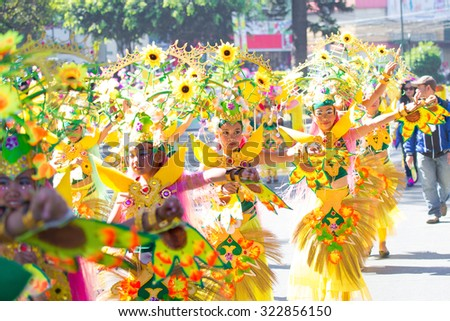 February 27, 2015 Baguio, Philippines. Baguio Citys Panagbenga Flower Festival. Unidentified people on parade in carnival costumes. Documentary Editorial Image. - stock photo