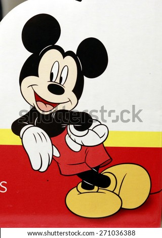 """FEBRUARY 2015 - BERLIN: the comic figure """"Mickey Mouse"""" on an electronic sign of a book store in the Prenzlauer Berg district of Berlin. - stock photo"""