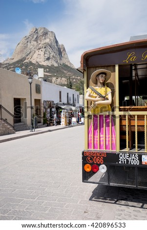 February 26,2016, Bernal, Mexico: tourist tour bus with the Bernal monolith in the background, the third largest monolyth in the world