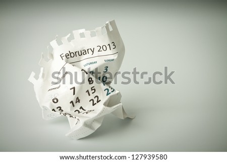 February. Calendar sheet. Crumpled paper on the floor. - stock photo