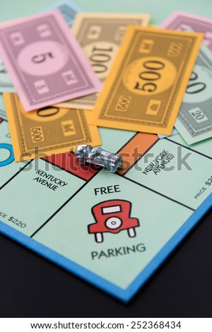 February 8, 2015 - Houston, TX, USA.  Monopoly car on Free Parking