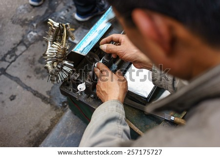 February 18, 2015 in Hanoi, Vietnam keys are being copied by an old machine. this is a livelihood on streets in Hanoi, Vietnam
