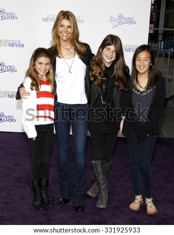 "February 8, 2011. Lori Loughlin at the Los Angeles premiere of ""Justin Bieber: Never Say Never"" held at the Nokia Theatre L.A. Live, Los Angeles."