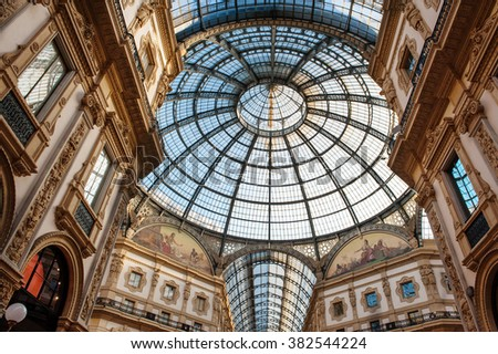 February 11, 2015 - Milan, Lombardy, Italy : Low angle view toward circular domed ceiling and windows inside the Vittorio Emanuele Milan shopping mall interior - stock photo