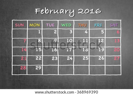 February 2016 Monthly calendar on black chalkboard background with colorful pastel day and dates in freehand grid time table chalk drawing: School/ business time planner conceptual idea for new year - stock photo