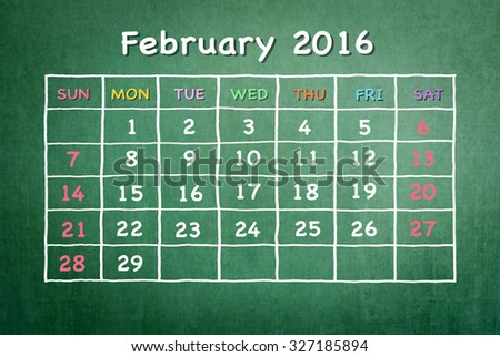 February 2016: Monthly calendar on green chalkboard background with colorful pastel day and dates in freehand grid time table chalk drawing: School/ business time planner conceptual idea for new year