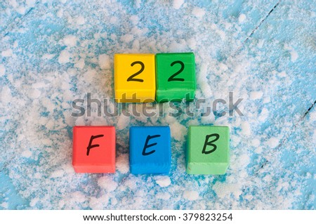 February 22nd. Calendar date on color wooden cubes with marked Date 22 of february. Winter end concept, leap year - stock photo