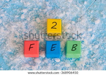 February 2nd. Calendar date on color wooden cubes with marked Date of 2nd Of february - stock photo