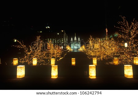FEBRUARY 2005 - Night display of 'world peace' sculptures during the 2002 Winter Olympics in the Mormon Square, Salt Lake City, UT - stock photo