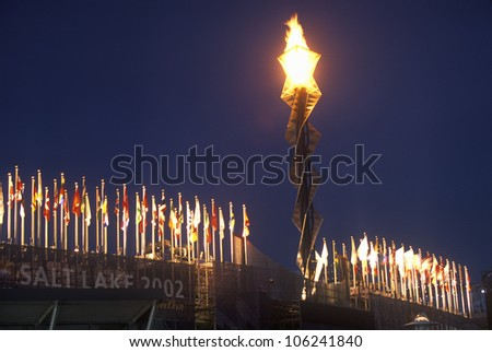 FEBRUARY 2005 - Olympic torch at night during the 2002 Winter Olympics, Salt Lake City, UT - stock photo