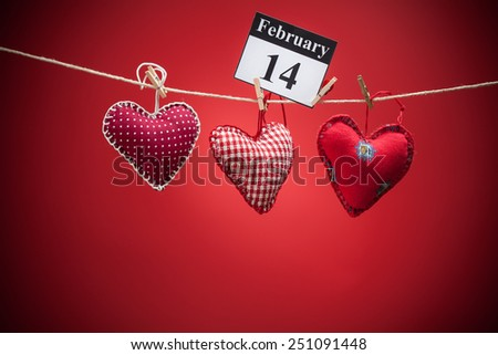 February 14, on the calendar, Valentine's day, red heart, red background - stock photo