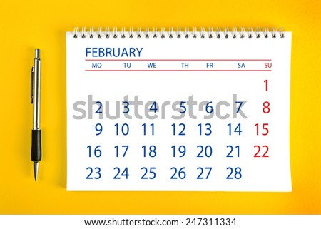 February Paper Calendar Page with Spiral Binding as Time Management and Schedule Concept, top view - stock photo