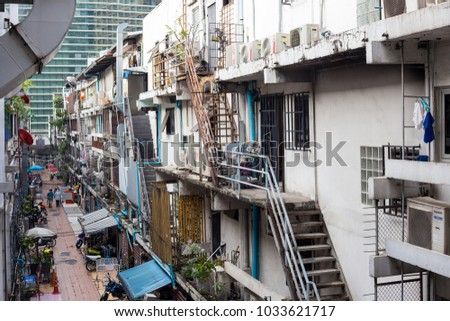 February 24, 2018 - people are doing their activities in the back side of commercial buildings at Siam Square, the famous shopping center in Bangkok, Thailand.