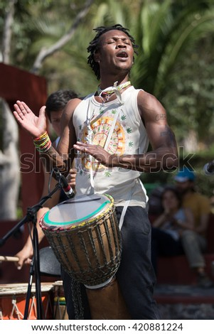 February 28, 2016 San Miguel de Allende, Mexico: african percussionist on stage during a public performance in Benito Juarez park