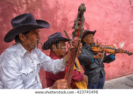 February 6, 2016 San Miguel de Allende, Mexico: local musicians performing on the street of the colonial tourist town for tips - stock photo
