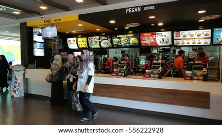 February 24th, 2017 - Selangor, MALAYSIA. Blurry movement of The activities among customers and fast food staffs inside McDonald's in Malaysia.