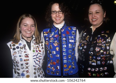 FEBRUARY 2005 - Tourists displaying vests covered with Olympic collector pins, during 2002 Winter Olympics, Salt Lake City, UT - stock photo