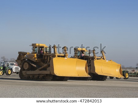 February 11, 2011 - Tulare, CA, USA: Two huge caterpillar bulldozers at a California heavy equipment auction.