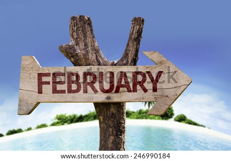 February wooden sign with a beach on background - stock photo
