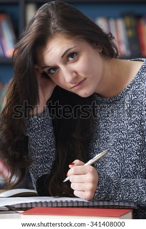 Fed Up Teenage Student In Library - stock photo