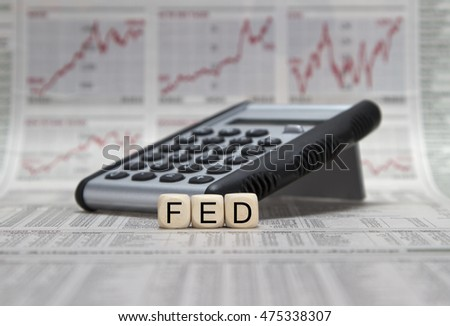 FED word with calculator on a business newspaper