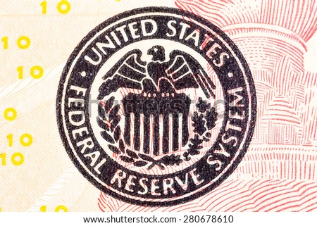 Federal Reserve icon on a ted dollar bill. - stock photo