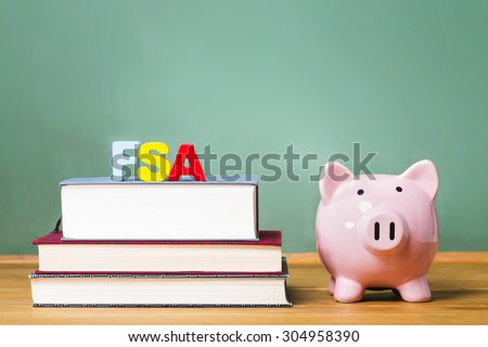 Federal Student Aid theme with textbooks and piggy bank and chalkboard background - stock photo