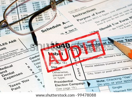 Federal tax forms being audited - stock photo