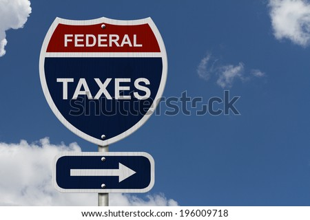 Federal Taxes this way, Blue and Red Interstate Sign with word Federal Taxes and an arrow with sky background - stock photo
