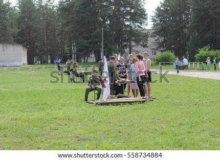 FEDULOVO, VLADIMIR REGION, RUSSIA - MAY 24, 2015: Training center for tank troops. Military sports game Zarnitsa among the children's clubs of the city Kovrov. Medical training