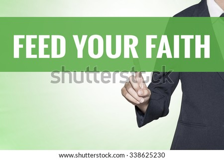 Feed Your Faith word on green virtual screen touching by business woman - stock photo