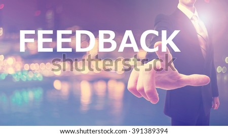 Feedback concept with businessman on blurred city background   - stock photo